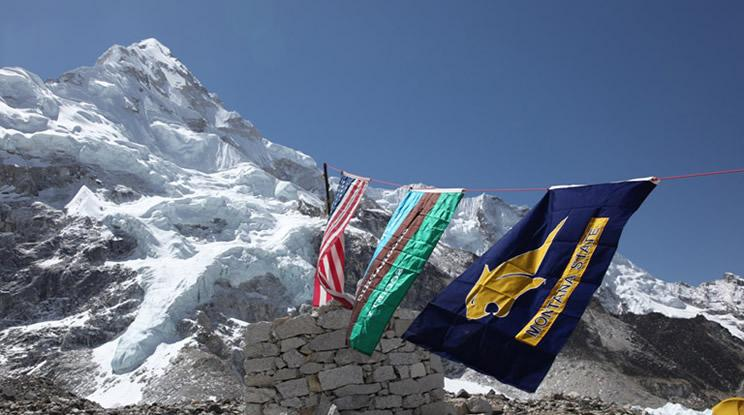 Bobcats at Base Camp! Montana State University flag flying at Everest Base Camp in Nepal, along with National Geographic and American flags. Photo: Dave Lageson
